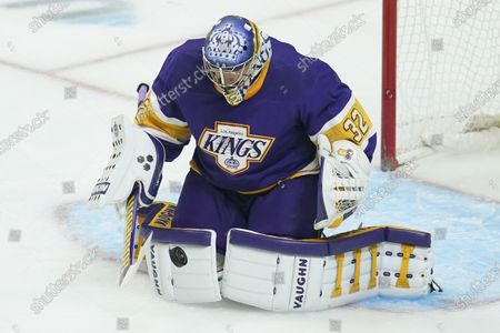 Los Angeles Kings goaltender Jonathan Quick (32) blocks a shot during the first period of an NHL hockey game against the Anaheim Ducks, in Los Angeles