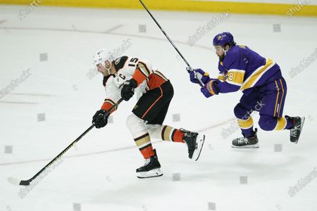 Anaheim Ducks center Ryan Getzlaf (15) controls the puck against Los Angeles Kings defenseman Drew Doughty (8) during the second period of an NHL hockey game, in Los Angeles