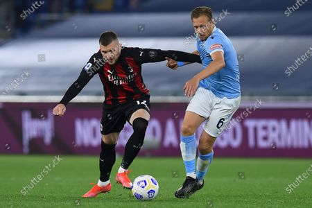 Ante Rebic of Milan Lucas Leiva of Lazio during the Italian Serie A soccer match SS Lazio v AC Milan in the Olympic stadium
