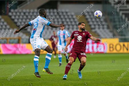 Kalidou Koulibaly of SSC Napoli and Tomas Rincon of Torino FC during the Serie A football match between Torino FC and SSC Napoli at Olympic Grande Torino Stadium on April 26, 2021 in Turin, Italy.