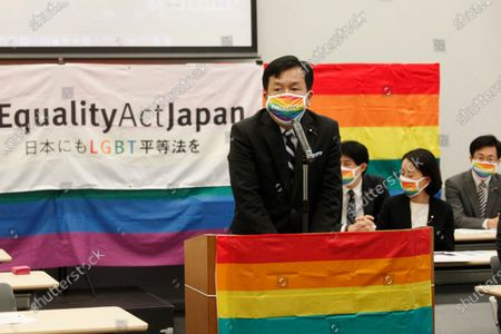 """Yukio Edano, head of the main opposition Constitutional of Democratic Party, wearing a rainbow colored mask speaks during a meeting of """"LGBT Equality Act Japan"""" in Tokyo, . Japanese activists, their supporters and lawmakers gathered in person and online at a """"Rainbow parliament"""" event Tuesday as they marked Japan's sexual minority pride week to gain momentum for their push toward an enactment of a LGBTQ equality law before the Olympics"""