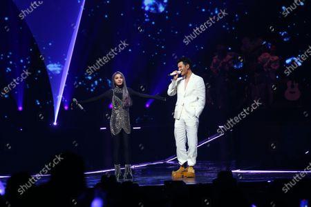 Stock Picture of Jolin Tsai and Eric Chou