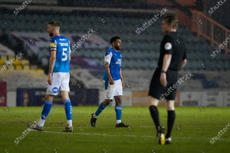 Nathan Thompson of Peterborough United (4) looks dejected