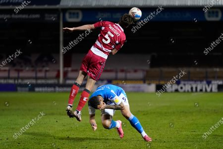 Jonson Clarke-Harris of Peterborough United (9) reacts after being hit by Joe Wright of Doncaster Rover (5)