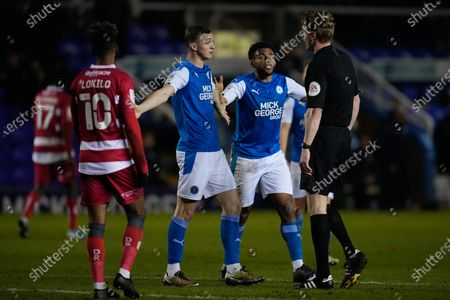Jack Taylor of Peterborough United (8) and Nathan Thompson of Peterborough United (4) react towards Referee Scott Oldham after an elleged handball