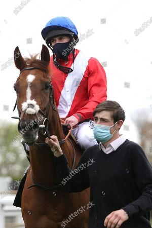 LIGHTS ON (2) ridden by Ryan Moore and trained by Sir Michael Stoute enter the Winners Enclosure after winning The Class 3 British Stallion Studs EBF Fillies Handicap over 1m during the meeting at Nottingham Racecourse, Nottingham