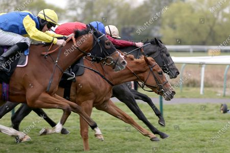 Stock Photo of ROMAN MIST (5) ridden by James Doyle and trained by Tom Ward winning The Follow @racingtv On Twitter Fillies Handicap over 1m during the meeting at Nottingham Racecourse, Nottingham