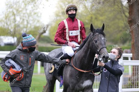 ROMAN MIST (5) ridden by James Doyle and trained by Tom Ward enter the Winners Enclosure after winning The Follow @racingtv On Twitter Fillies Handicap over 1m during the meeting at Nottingham Racecourse, Nottingham