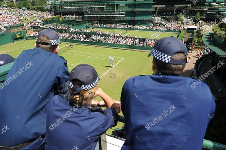 Wimbledon Tennis Championships 2009 Police Officers Watching Play During The Katie O'brien V Iveta Benesova Match... 23/06/09