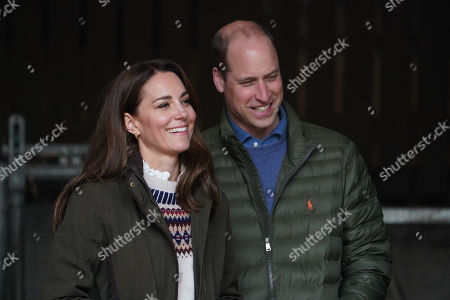 Prince William and Catherine Duchess of Cambridge walk together during their visit to Manor Farm in Little Stainton, Durham.