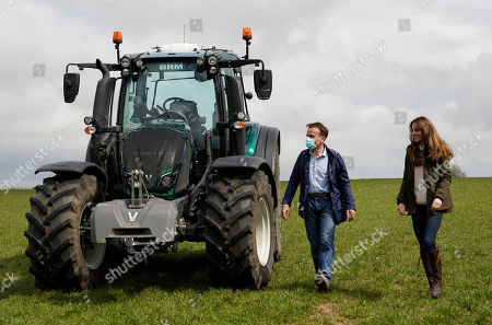 Farmer Stewart Chapman walks with Catherine Duchess of Cambridge after she drove a tractor during a visit to Manor Farm in Little Stainton, Durham.