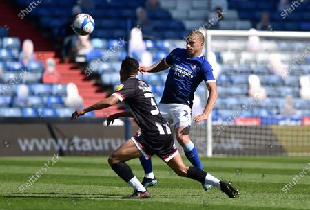 Stock Image of Oldham Athletic's Harry Clarke tussles with Evan Khouri of Grimsby Town during the Sky Bet League 2 match between Oldham Athletic and Grimsby Town at Boundary Park, Oldham, England on 24th April 2021.