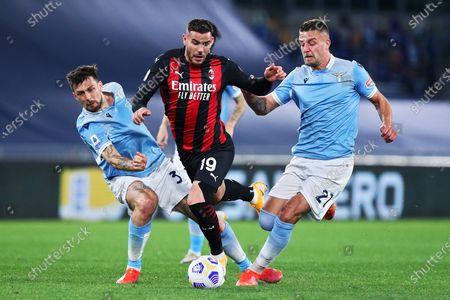 Francesco Acerbi (L-Lazio) Sergej Milinkovic Savic (R-Lazio) Theo Hernandez (C- Milan) during the match