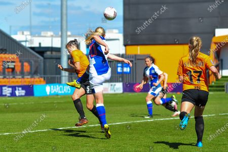 Elise Hughes (10 blackburn rovers) shot deflected by Georgia Robert (5 london bees) during the Women's FA Championship match between London Bees and Blackburn Rovers, England.