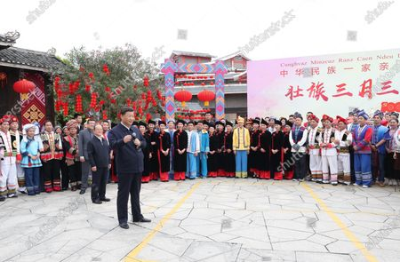 (210427) - NANNING, April 27, 2021 (Xinhua) - Chinese President Xi Jinping, also general secretary of the Communist Party of China Central Committee and chairman of the Central Military Commission, talks to people of different ethnic groups who are participating in festive activities outside the Anthropology Museum of Guangxi in the city of Nanning, south China. Guangxi Zhuang Autonomous Region, April 27, 2021. Xi made an inspection trip to south China's Guangxi Zhuang Autonomous Region from April 25 to April 27.