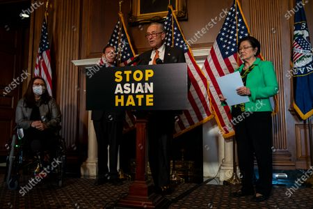 Stock Picture of Senate Majority Leader Chuck Schumer (D-NY), flanked by (L-R) Sen. Tammy Duckworth (D-IL), Sen. Richard Blumenthal, (D-CT) and Sen. Mazie Hirono (D-HI), speaks during a news conference about the passage of S. 937, Covid-19 Hate Crimes Act on Capitol Hill on Thursday, April 22, 2021 in Washington, DC. The Bill passed, amended by a vote of 94-1, with Sen. Josh Hawley was the lone vote against. (Kent Nishimura / Los Angeles Times)