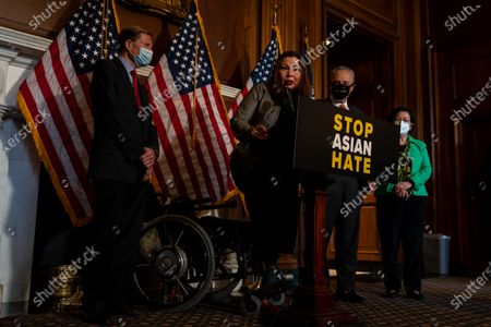 Sen. Tammy Duckworth (D-IL), second from left, speaks during a news conference about the passage of S. 937, Covid-19 Hate Crimes Act on Capitol Hill on Thursday, April 22, 2021 in Washington, DC. The Bill passed, amended by a vote of 94-1, with Sen. Josh Hawley was the lone vote against. (Kent Nishimura / Los Angeles Times)