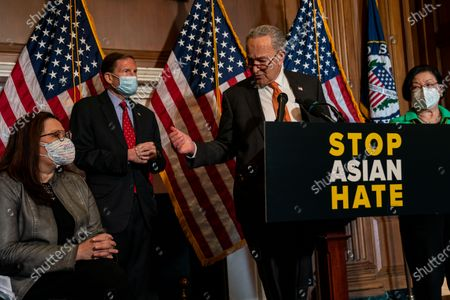 Stock Image of Senate Majority Leader Chuck Schumer (D-NY), flanked by (L-R) Sen. Tammy Duckworth (D-IL), Sen. Richard Blumenthal, (D-CT) and Sen. Mazie Hirono (D-HI), speaks during a news conference about the passage of S. 937, Covid-19 Hate Crimes Act on Capitol Hill on Thursday, April 22, 2021 in Washington, DC. The Bill passed, amended by a vote of 94-1, with Sen. Josh Hawley was the lone vote against. (Kent Nishimura / Los Angeles Times)