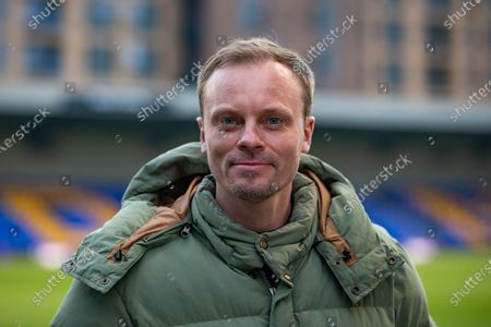 Stock Image of William Daniels, Will, AFC Wimbledon Recruitment & Analysis Manager, during half time in the EFL Sky Bet League 1 match between AFC Wimbledon and Rochdale at Plough Lane, London