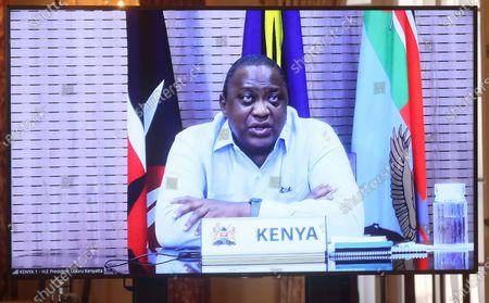 Kenyan President Uhuru Kenyatta appears on a screen as he speaks during a virtual bilateral meeting with Secretary of State Antony Blinken at the State Department in Washington