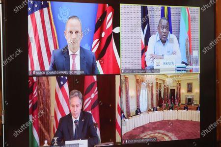 Secretary of State Antony Blinken participates in a virtual bilateral meeting with Kenyan President Uhuru Kenyatta and Chargé d'Affaires Eric Kneedler at the State Department in Washington