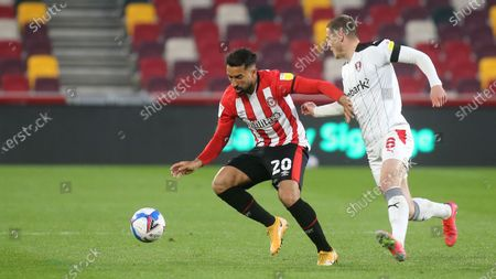 Stock Picture of Saman Ghoddos of Brentford shields the ball from Rotherham's Ben Wiles during Brentford vs Rotherham United, Sky Bet EFL Championship Football at the Brentford Community Stadium on 27th April 2021