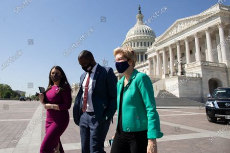 Democratic Senator from Massachusetts Elizabeth Warren, Democratic Representative from New York Mondaire Jones (C) and Democratic Representative from California Sara Jacobs (L) walk outside the US Capitol before a news conference in Washington, DC, USA, 27 April 2021. The news conference was held to discuss the Universal Child Care and Early Learning Act, which aims to reduce child care costs.