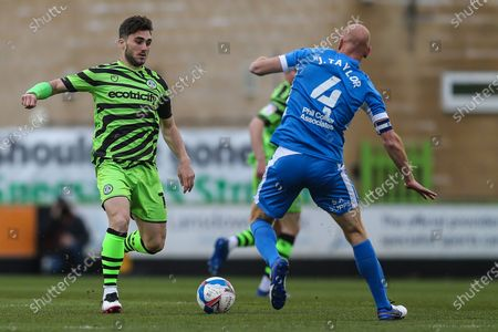 Forest Green Rovers Jordan Moore-Taylor(15) takes on Barrow Midfielder Jason Taylor (4) during the EFL Sky Bet League 2 match between Forest Green Rovers and Barrow at the New Lawn, Forest Green