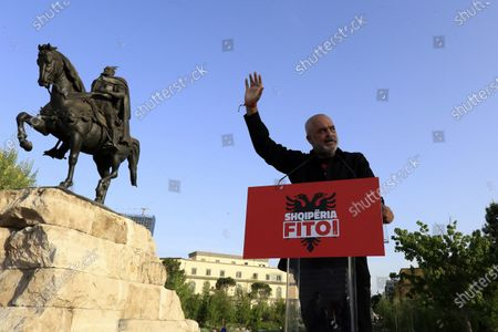 Albania's Prime Minister Edi Rama waves to his supporters during a rally in Tirana, Albania, . Albania's left-wing Socialist Party has secured a third consecutive mandate in a parliamentary election, winning a majority of seats in parliament, Prime Minister Edi Rama said on Tuesday