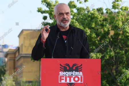 """Stock Photo of Albania's Prime Minister Edi Rama speaks to his supporters during a rally in Tirana, Albania, . Albania's left-wing Socialist Party has secured a third consecutive mandate in a parliamentary election, winning a majority of seats in parliament, Prime Minister Edi Rama said on Tuesday. The podium reads """"Albania Won"""