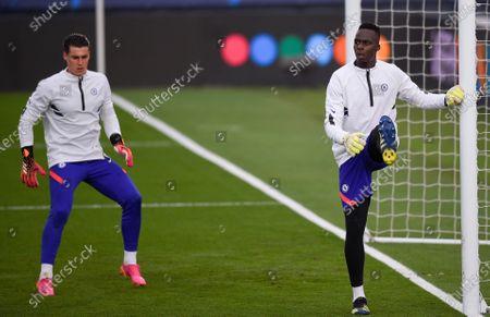 Goalkeeper Kepa Arrizabalaga of Chelsea warms up alongside fellow keeper Edouard Mendy