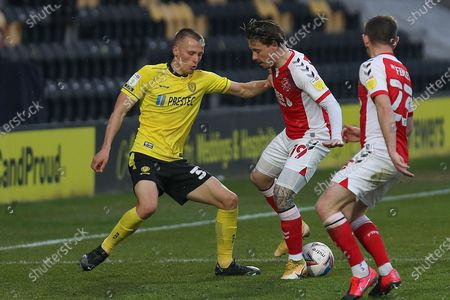 Burton Albion defender Tom Hamer (37) and Fleetwood Town midfielder Barrie McKay (19) during the EFL Sky Bet League 1 match between Burton Albion and Fleetwood Town at the Pirelli Stadium, Burton upon Trent