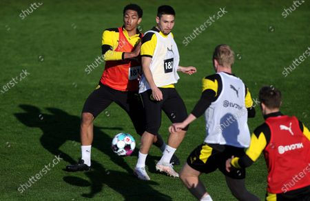 Dortmund players Jude Bellingham (L) and Raphael Guerreiro (2-L) perform during their team's training session in Dortmund, Germany, 27 April 2021. Borussia Dortmund will face Holstein Kiel in their German DFB Cup semi final soccer match on 01 May 2021.