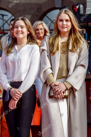 Stock Photo of Royal Couple King Willem-Alexander and Queen Maxima and Princess Ariane Alexia and Amalia provide a stage for The Streamers' online concert on King's Day The Streamers consist of Guus Meeuwis, Rolf Sanchez, Kraantje Pappie, Suzan & Freek, VanVelzen, Davina Michelle, Paul de Munnik, Typhoon, Thomas Acda, Diggy Dex, Nick & Simon, Maan, Danny Vera, Miss Montreal and Paul de Leeuw. Band manager Frank Lammers is also present.