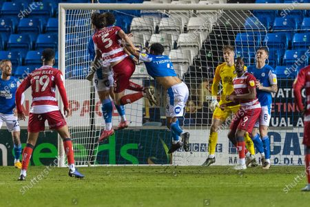 Doncaster defender Joe Wright (5) gets a header during the EFL Sky Bet League 1 match between Peterborough United and Doncaster Rovers at London Road, Peterborough