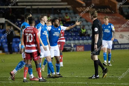 Peterborough Utd Defender Nathan Thompson (4) leads the demands for a penalty from Referee Scott Oldham during the EFL Sky Bet League 1 match between Peterborough United and Doncaster Rovers at London Road, Peterborough
