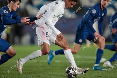 Real Madrid's Raphael Varane runs with the ball during the Champions League semifinal first leg soccer match between Real Madrid and Chelsea at the Alfredo di Stefano stadium in Madrid, Spain