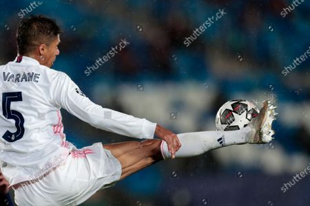 Real Madrid's Raphael Varane reaches for the ball during the Champions League semifinal first leg soccer match between Real Madrid and Chelsea at the Alfredo di Stefano stadium in Madrid, Spain