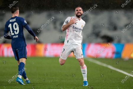 Real Madrid's Dani Carvajal reacts next to Chelsea's Mason Mount, left, during the Champions League semifinal first leg soccer match between Real Madrid and Chelsea at the Alfredo di Stefano stadium in Madrid, Spain