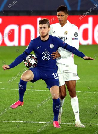 Real Madrid's Raphael Varane (R) in action against Chelsea's Timo Werner (L) during the UEFA Champions League semi final, first leg soccer match between Real Madrid CF and Chelsea FC at Alfredo Di Stefano stadium in Madrid, Spain, 27 April 2021.