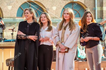 Queen Maxima with their daughters Princess Amalia, Princess Alexia and Princess Ariane at the final repetitions of The Streamers (a band with multiple Dutch artists), befor the live concert takes place at Noordeinde Palace, that everyone can stream from their home.