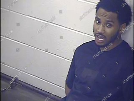 "In this undated photo provided by the Jackson County Detention Center, In Kansas City, Missouri shows Trey Songz. Prosecutors have declined to file charges against R&B artist Trey Songz stemming from an altercation with police officers at the AFC championship game in Kansas City. Mike Mansur, a spokesman for the Jackson County prosecutor's office, said, that there was ""insufficient evidence"" to prosecute the case and that police were notified of the decision late last week"