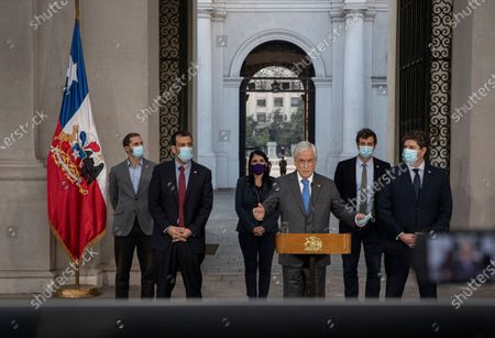 Chile's President Sebastian Pinera talks during a press conference at a La Moneda goverment palace in Santiago, . Pinera suffered a new defeat regarding the withdrawal of private pension funds after the Constitutional Court rejected his request to declare unconstitutional an already approved bill that allows millions of Chileans to withdraw up to 10% of their retirement savings
