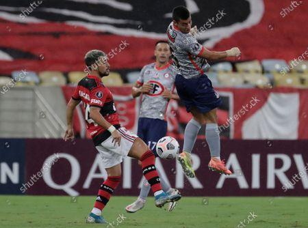 Giorgian De Arrascaeta of Brazil's Flamengo, left, and Esteban Valencia of Chile's Union La Calera battle for the ball during a Copa Libertadores soccer match at the Maracana stadium in Rio de Janeiro, Brazil