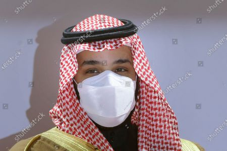 Stock Photo of Saudi Crown Prince Mohammed bin Salman wears a face mask to help curb the spread of the coronavirus as he attends the Saudi Cup award ceremony during the final race of the $20 million, the Saudi Cup, at King Abdul Aziz race track in Riyadh, Saudi Arabia. The crown prince laid out a vigorous defense of his domestic policies and the thinking behind his push to transform Saudi Arabia economically and socially during a wide-ranging interview broadcast across Saudi television channels late