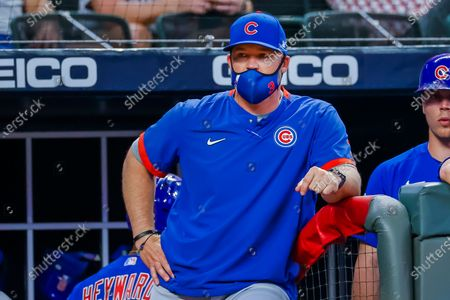 Chicago Cubs manager David Ross watches the game during the eighth inning of the MLB baseball game between the Chicago Cubs and the Atlanta Braves at Truist Park in Atlanta, Georgia, USA, 27 April 2021.