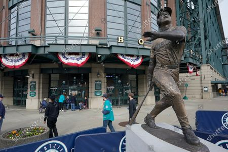 The statue of Seattle Mariners' Ken Griffey Jr. is shown in front of T-Mobile Park on opening day before a baseball game between the Mariners and the San Francisco Giants, in Seattle