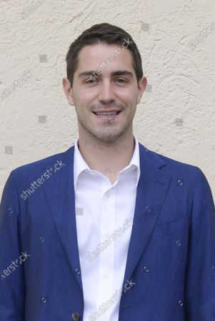 Stock Image of Tommaso Zorzi poses for photographs on arrival at the studios for the recording of the last episode of the maurizio costanzo show 2021.