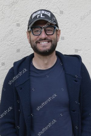 Stock Photo of Enrico Papi poses for photographs on arrival at the studios for the recording of the last episode of the maurizio costanzo show 2021.