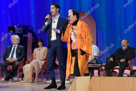Cristiano Malgioglio and Tommaso Zorzi sing during the broadcast Maurizio Costanzo Show last episode 2021.